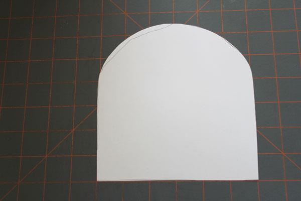 cutting cardboard in arched shape