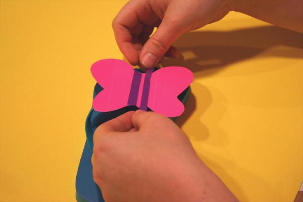 adding duct tape butterfly to the top of slipper