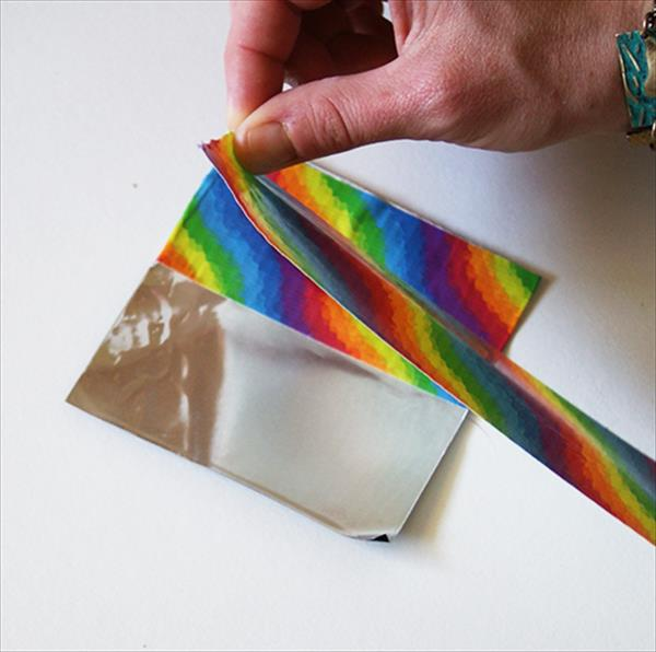 wrapping the duct tape on cardboard
