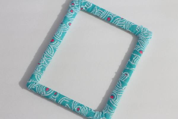 wrapping of frame with fabric