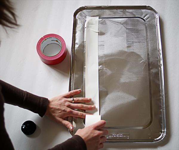 filling the foil lid with white duct tape